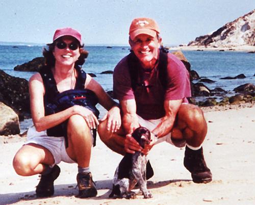 Cynthia, her husband Buzz, and puppy Josie on the beach near Devil's Bridge,